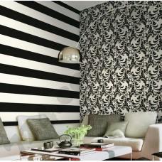 Интерьер Roberto Cavalli обои Emiliana Parati ROBERTO CAVALLI артикул 12049;12054 в интрьере гостиной комнаты в черно-белых тонах